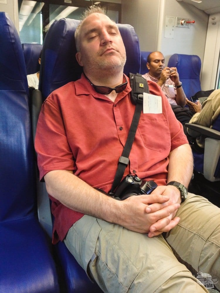 Grant napping on the train after a long day of travel.