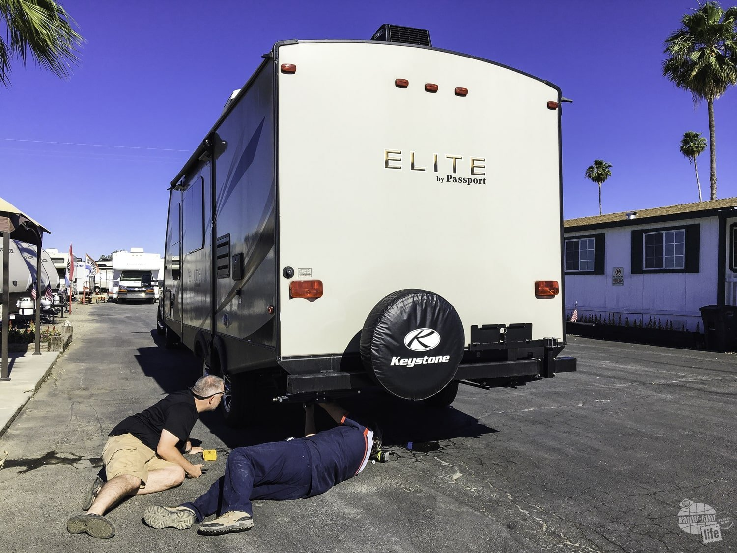 Grant assisting James while he provides RV service.