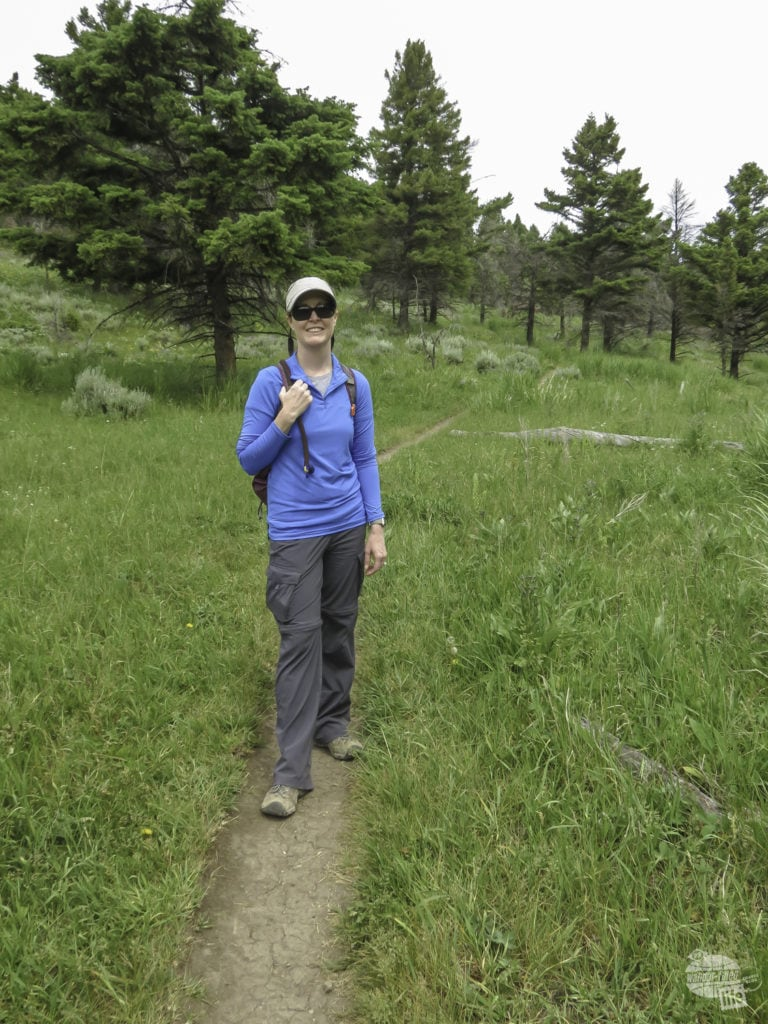Bonnie on the trail in Yellowstone. Convertible pants are a great items for your Yellowstone packing list.