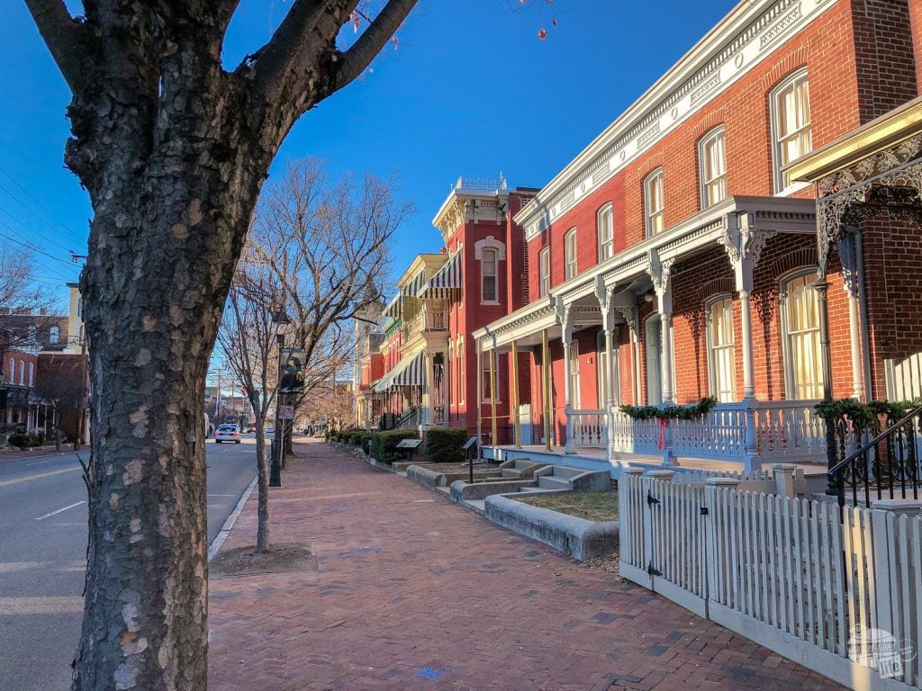 Walker's home (with the striped awnings) is located on Leigh Street in the heart of the Jackson Ward district in Richmond.