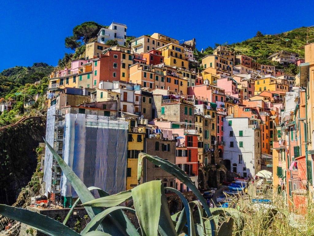 Vibrantly colored houses cover the hillside of Riomaggiore in the Cinque Terre.