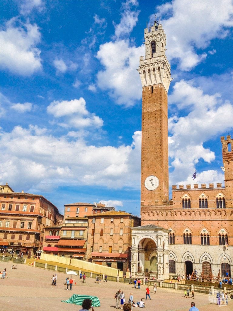 The bell tower in the Campo, or main square, of Siena.
