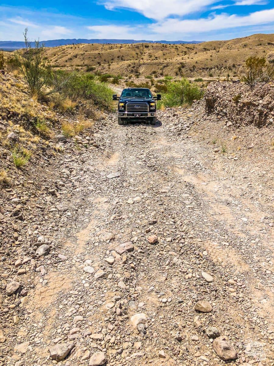 F-150 climbing a rough stretch of road