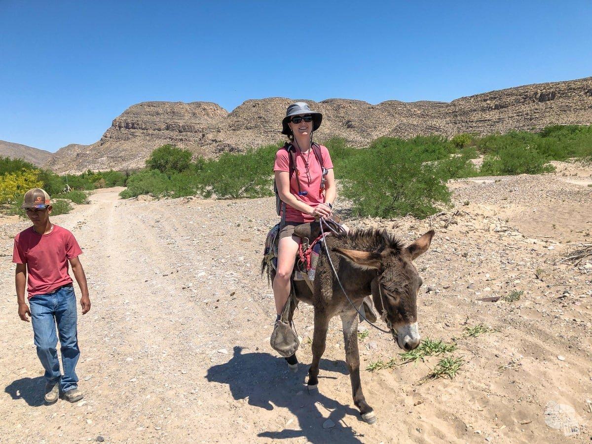 Riding a burro into town in Mexico!