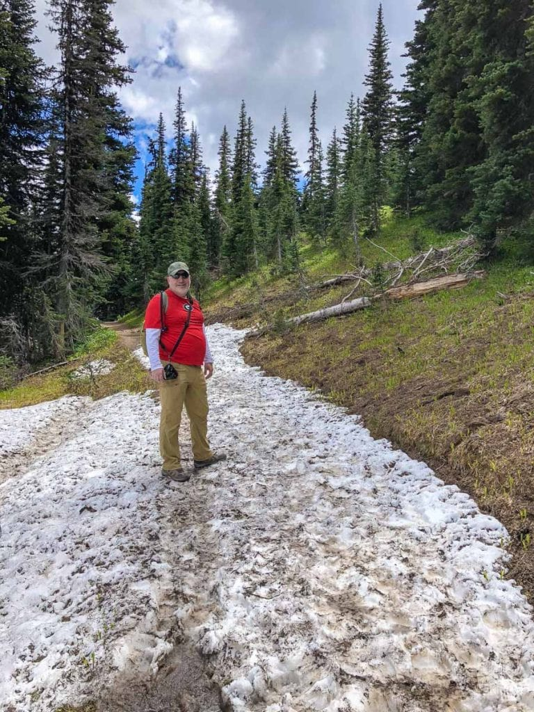Grant crossing the snowfield on the trail.