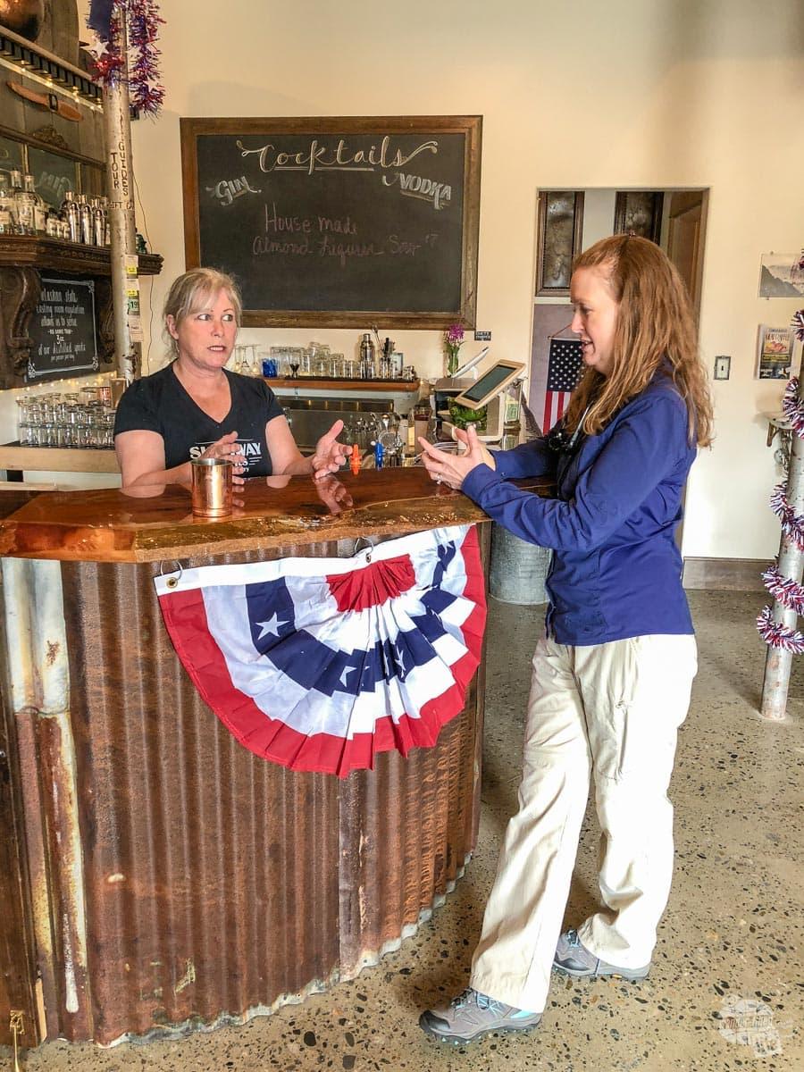 Bonnie talking drinks at Skagway Spirits.
