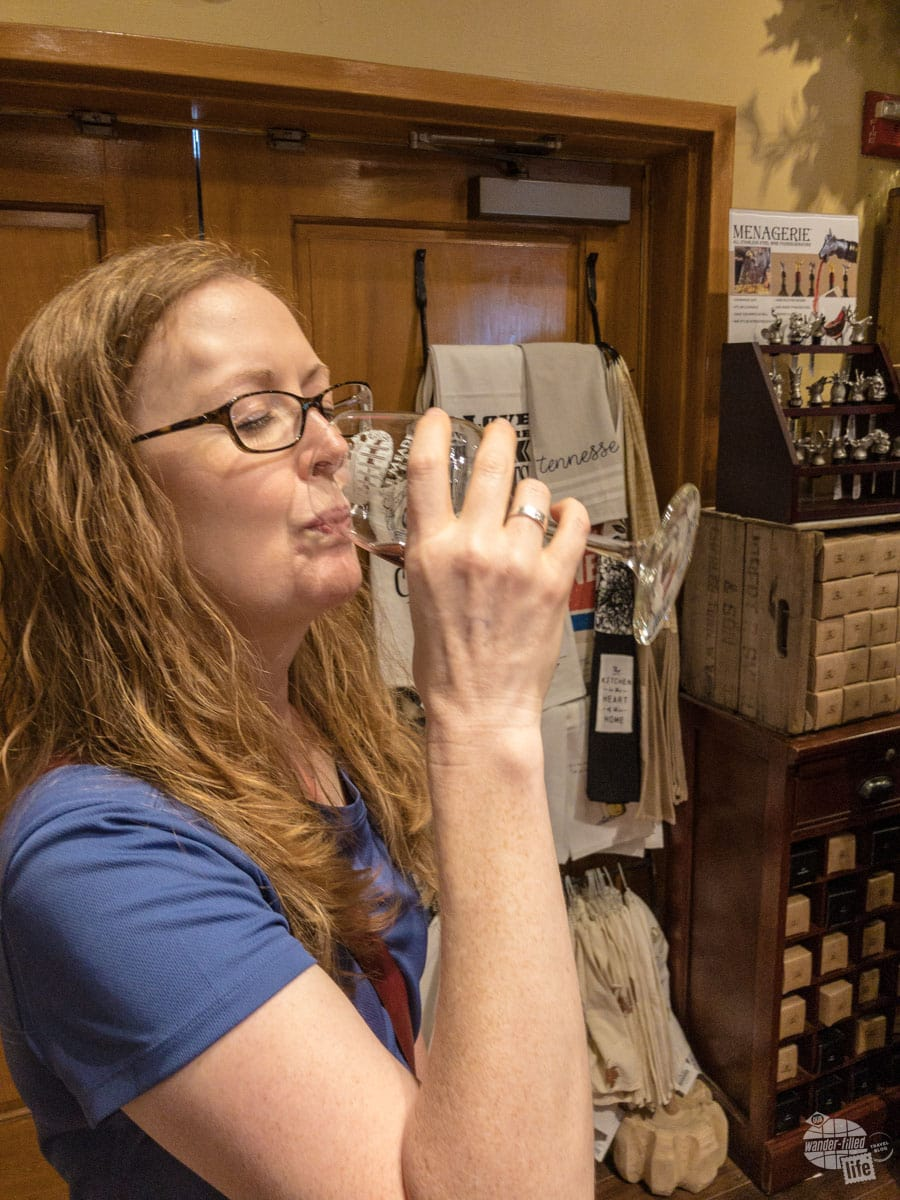 Bonnie sampling one of the red wines at Belle Meade Plantation Winery.