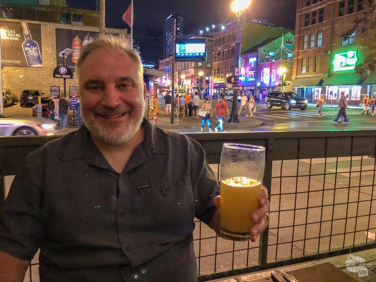Grant enjoying a hefeweizen from Rock Bottom Brewery.