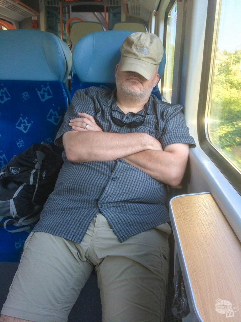 Grant taking a nap on the train back to Krakow.