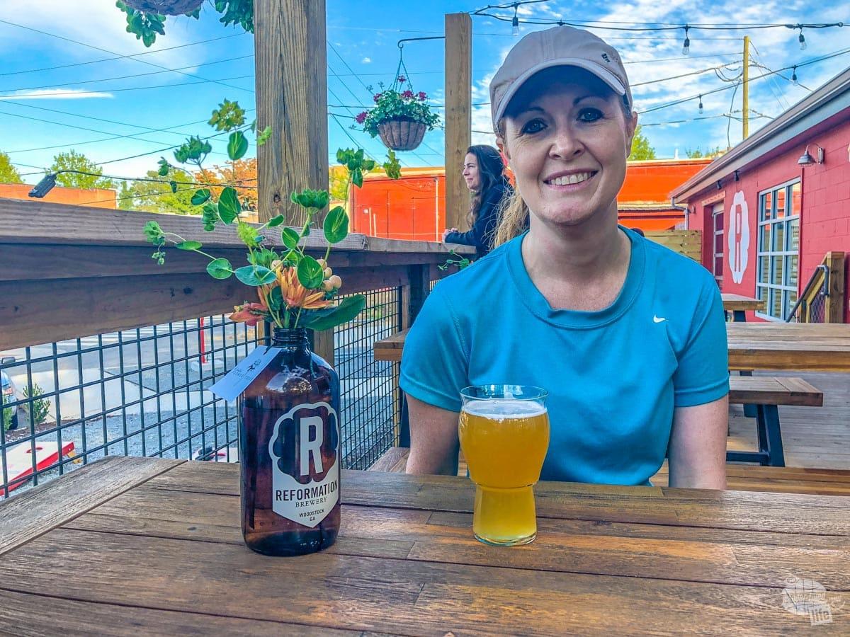 Bonnie enjoying a tasty beer at Reformation Brewery.