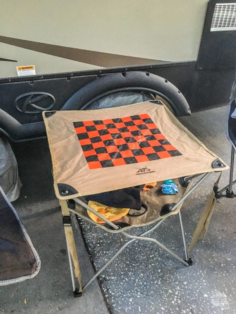 Camp table with checker board
