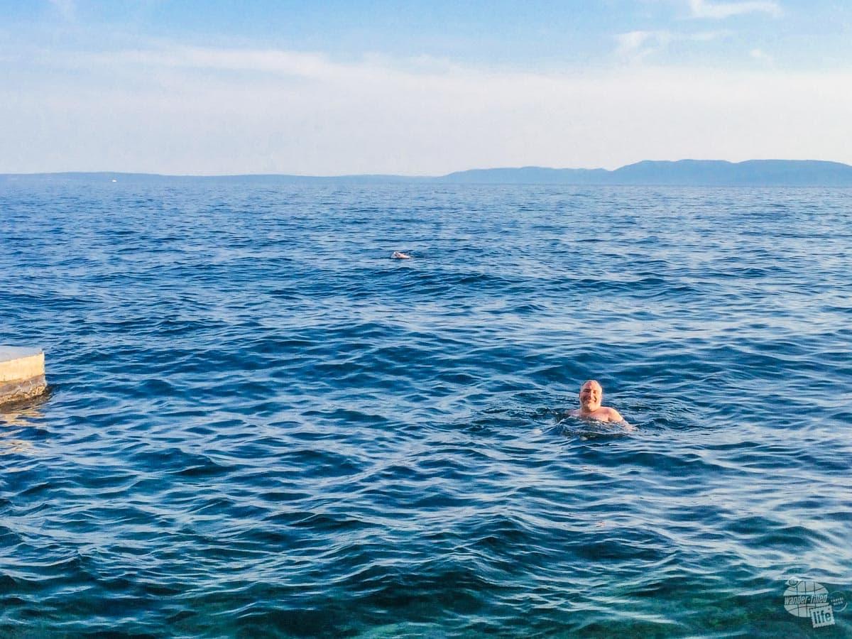 Grant swimming in the Adriatic Sea in Rijeka.