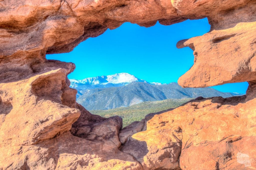 Pikes Peak through the window in the Siamese Twins