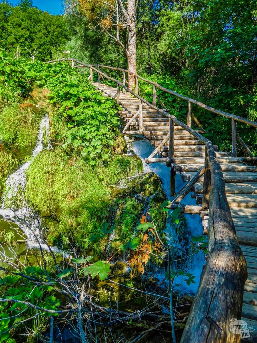 Stairs taking visitors over a cascade in Plitvice National Park.