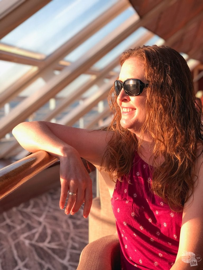 Bonnie in the Spinnaker Lounger aboard the Norwegian Sky at sunset. Portrait mode on the iPhone X makes for some great images.