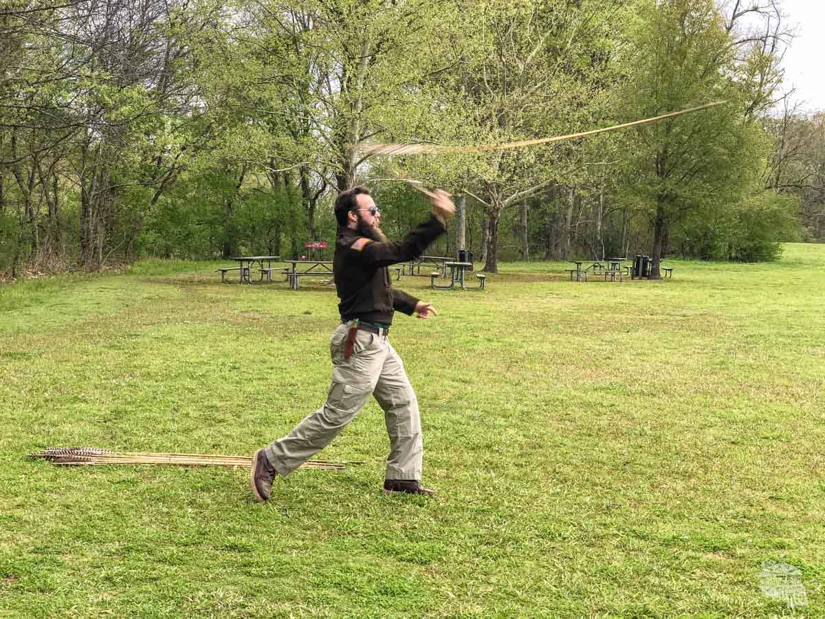 One of the rangers at Poverty Point demonstrating how an atlatl is used.