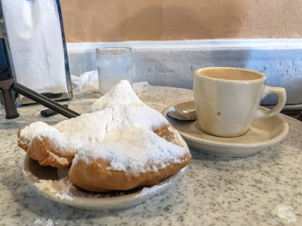Beignets and cafe au lait at Cafe Du Monde in New Orleans.