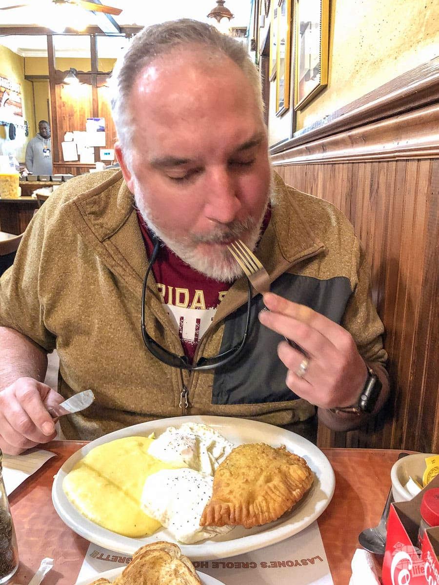 Grant enjoying a meat pie breakfast at Lasyone's Meat Pie Restaurant. The pie and the grits were to die for!
