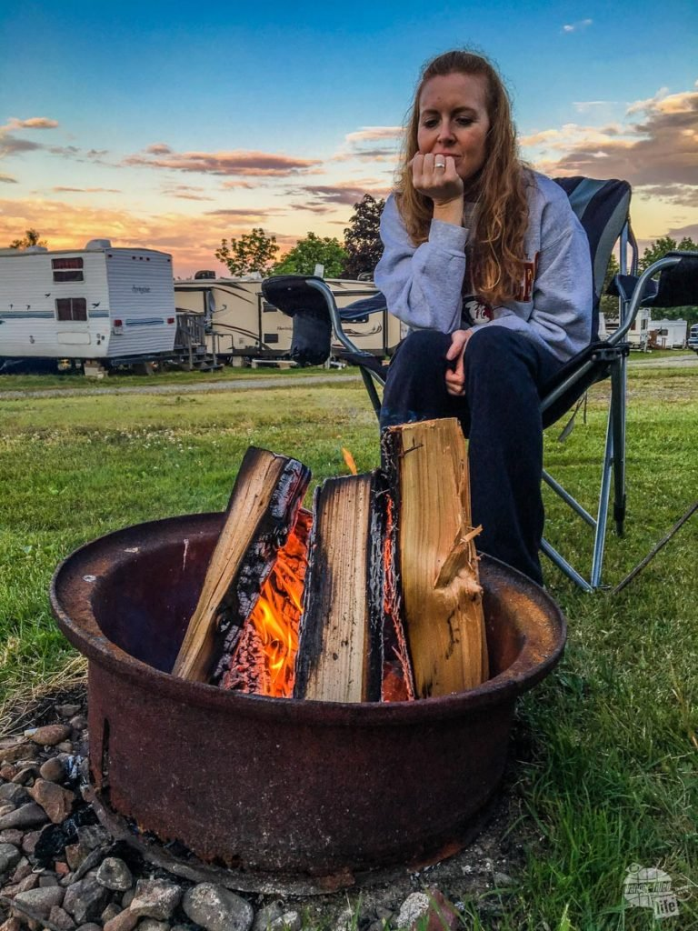 Bonnie enjoying the warmth of a campfire at our campground.