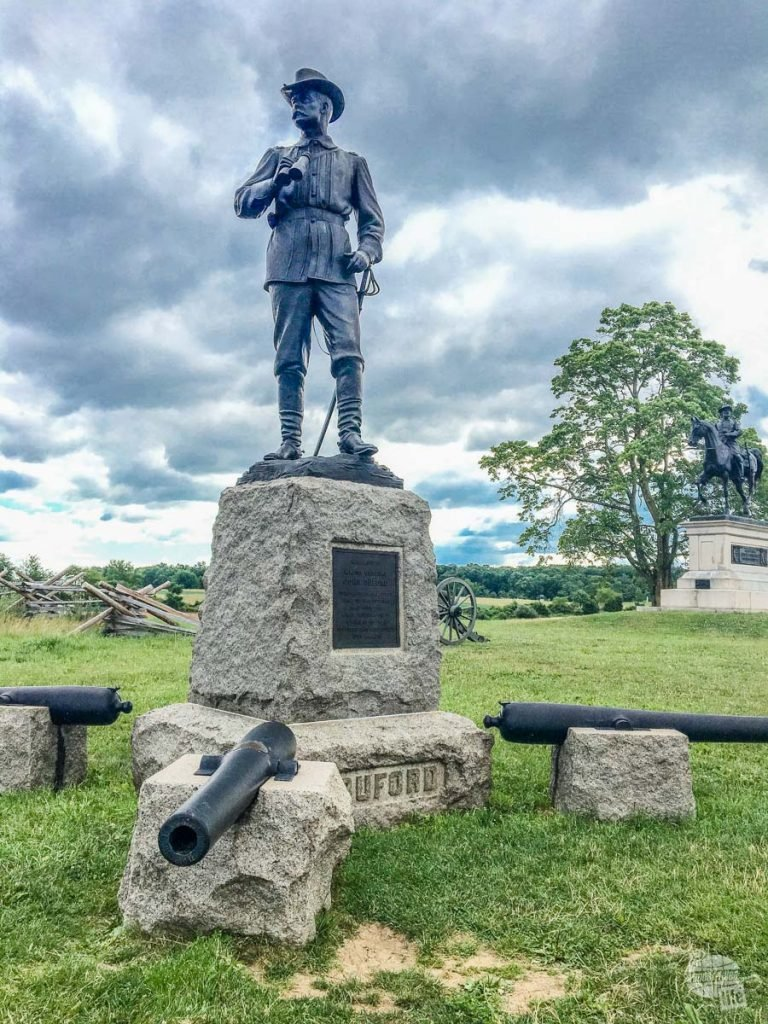 General Buford commanded the Union cavalry at Gettysburg. It was his decisive action to hold against a force three times his size which allowed time for Union troops to occupy the high ground around Gettysburg. The cannon in the foreground fired the first shot of the battle.