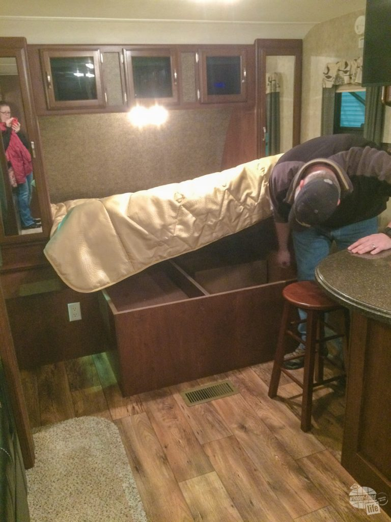 Grant checking out the under-bed storage of the 23RB. We ended up falling in love with this RV.