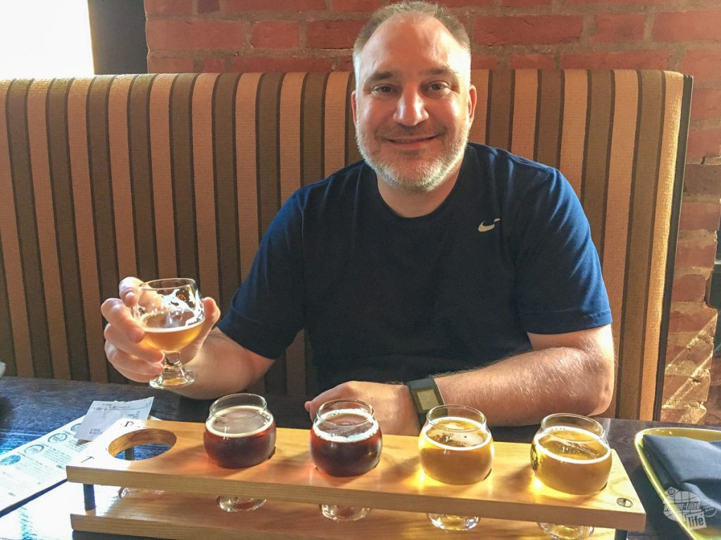 Grant enjoying a flight of beer at the Mill House Brewing Company.