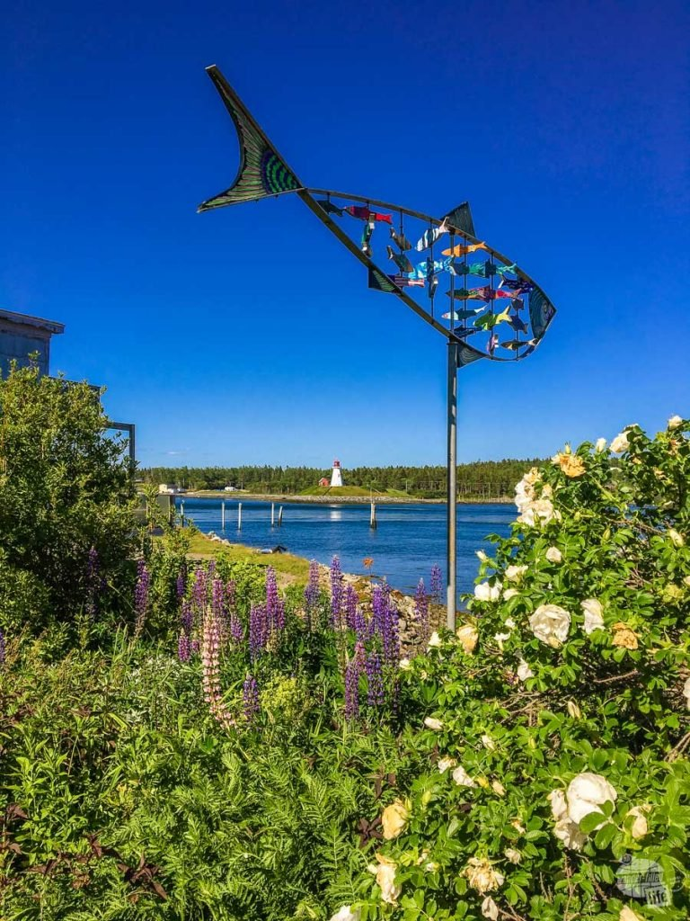 Street are in Lubec with the Mullholland Point Light (in Canada) in the distance.