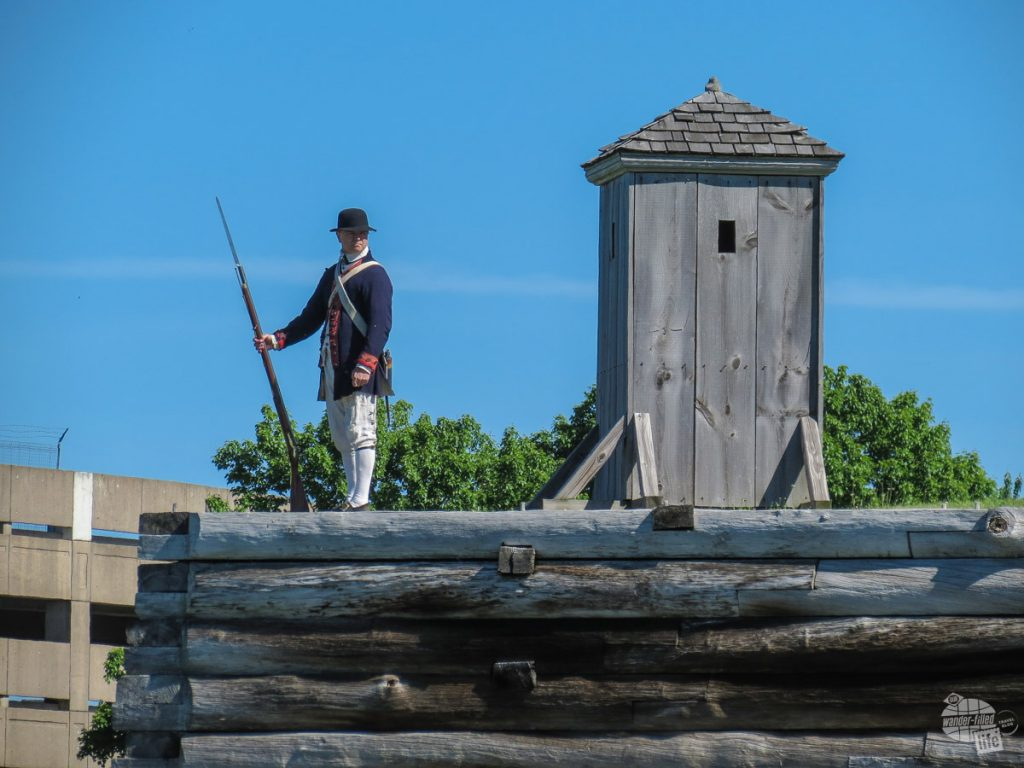 A park volunteer dressed as a colonial sentry stands watch.