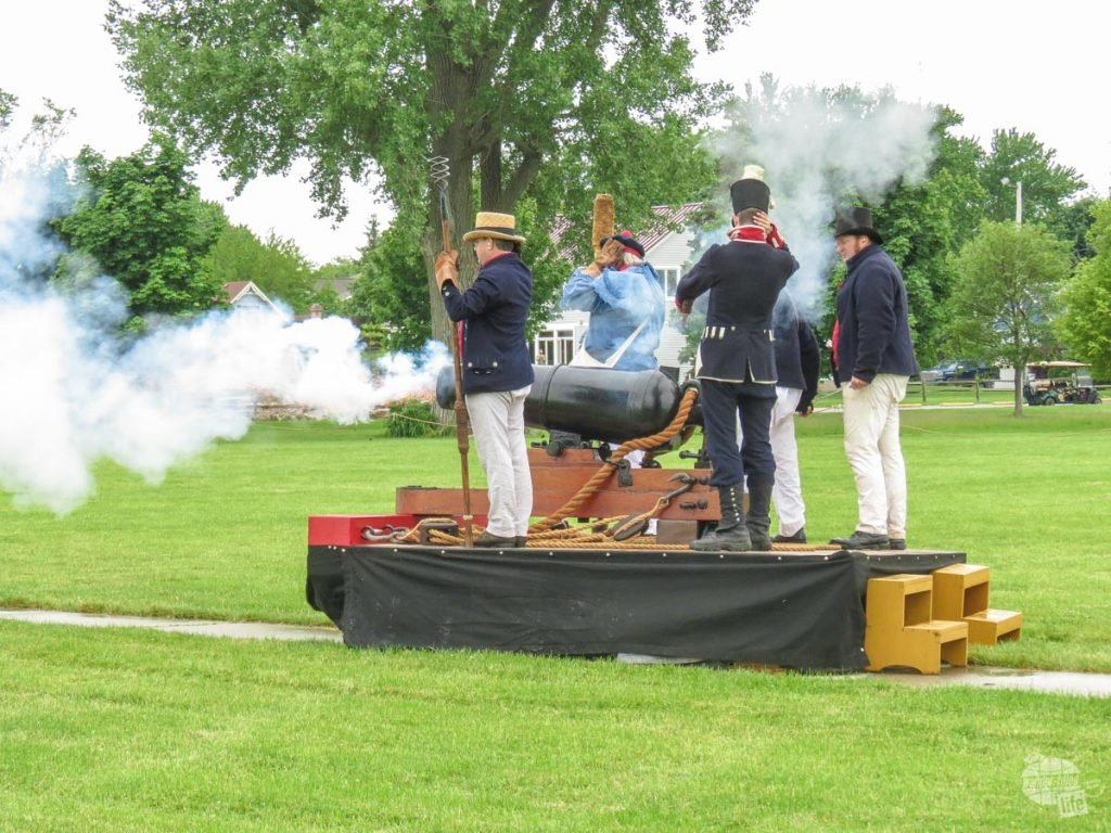 Park Service volunteers demonstrate the firing of a carronade. A carronade is basically a short range cannon, firing heavier projectiles but at half the range.