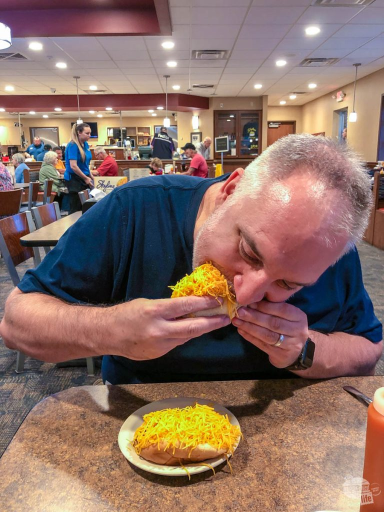 Grant munching on a Coney at Skyline Chili.