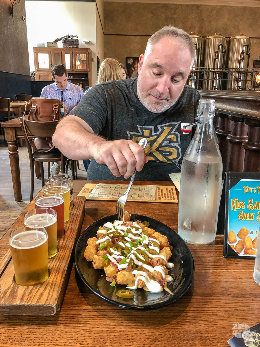 Grant digging in on the loaded tots at the Taft's Ale House.