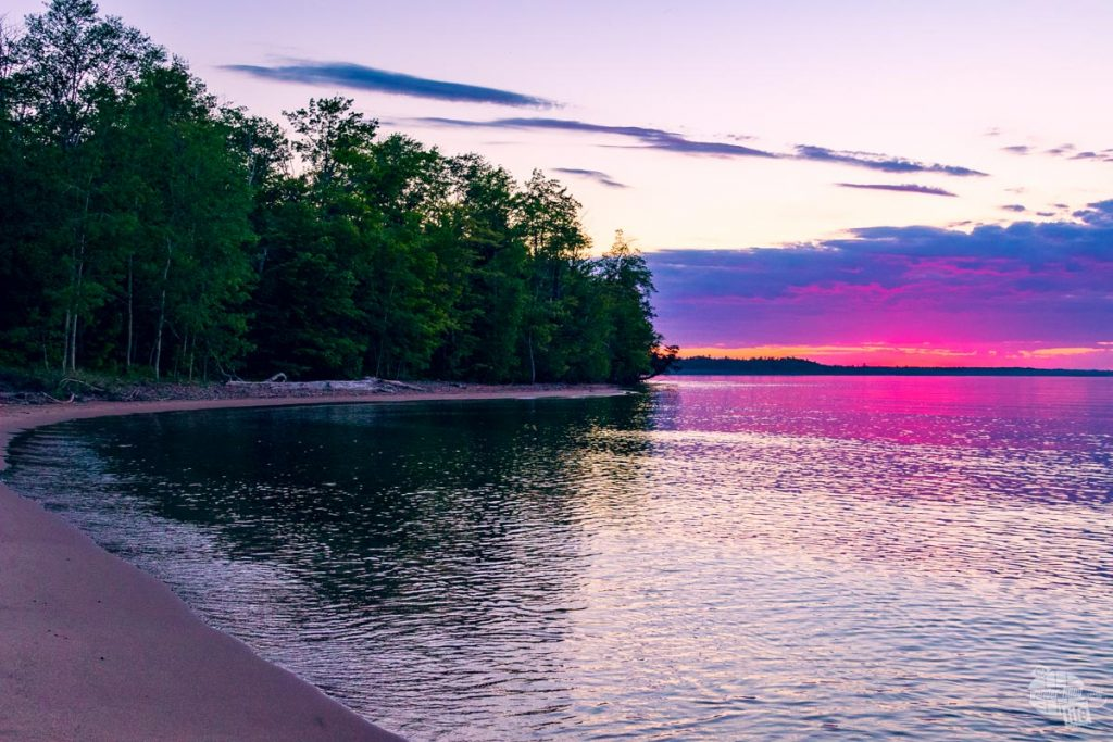A pink and purple sky during a sunset over Lake Superior in Munising, MI.
