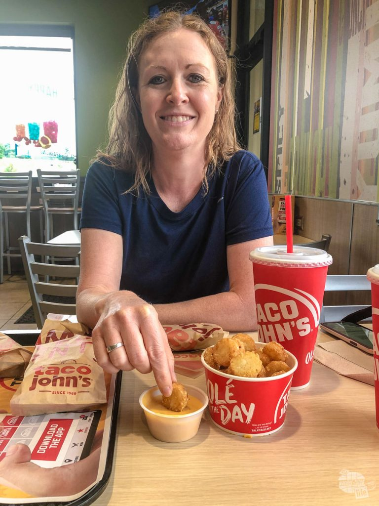 Bonnie dunking a potato ole at Taco John's, one of our favorite fast food joints.