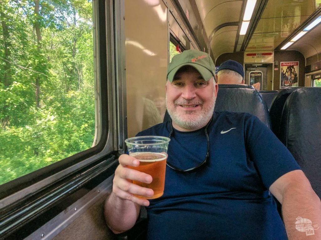 Grant enjoying a beer aboard the Cuyahoga Valley Scenic Train.