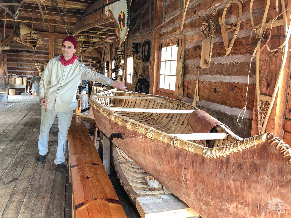 One of the living historians goes over the structure of a birch bark canoe.