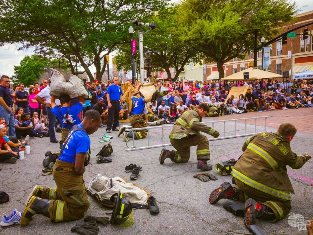 Members of the Macon-Bibb Fire Department hustle to put on their gear before running a relay.