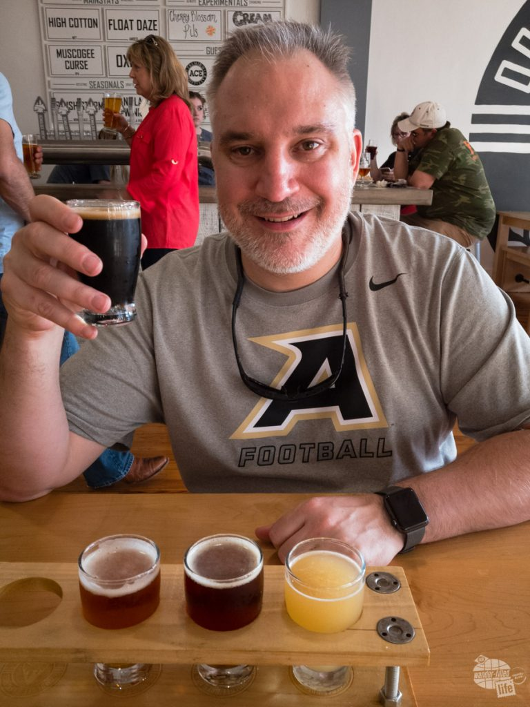 When at a new brewpub, like the Ocmulgee Brewpub in Macon, the first thing Grant does is sample a flight of the house brews.