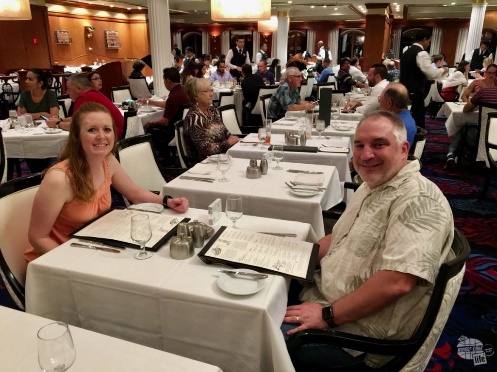 Grant and Bonnie enjoying a meal in the main dining room on Royal Caribbean's Adventure of the Seas. Nearly unlimited food is a big pro of cruising.