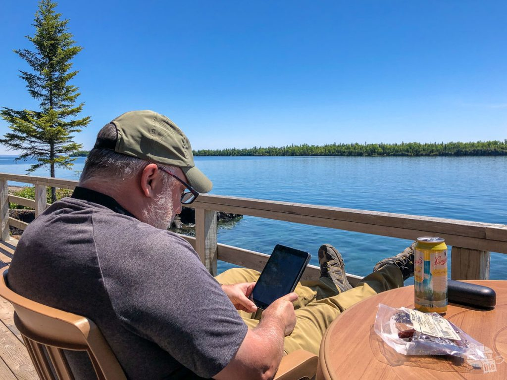 Grant enjoying a perfect lunch: a meat bites, a pint of beer, a good book and a great view.