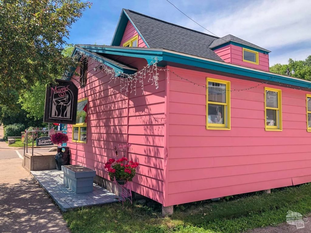 The bright pink building for Maggie's, a restaurant in Bayfield, WI.