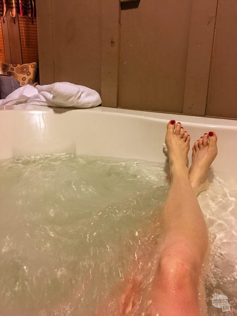 Bonnie relaxing in the Jacuzzi tub in our treehouse room at Historic Banning Mills.