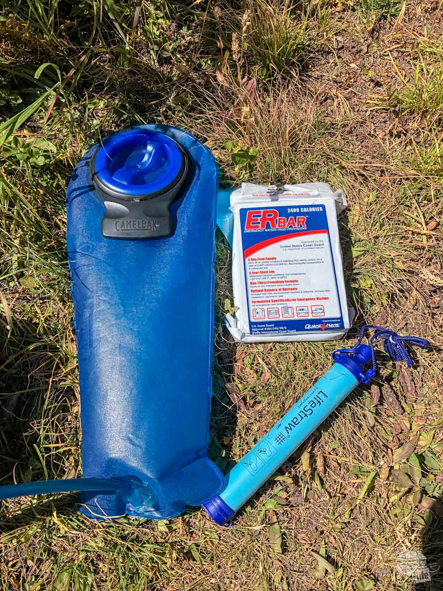 e always carry a 3L CamelBak water bladder, along with a Lifestraw filter for emergencies. We take extra food but the ERBar is a 2,400-calorie emergency food supply for the both of us.