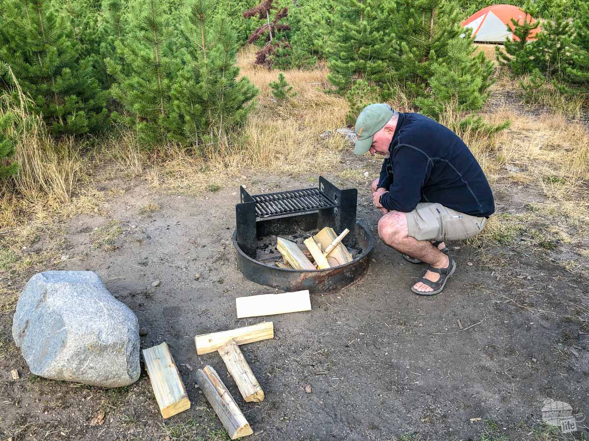 Grant building a campfire in Rocky Mountain National Park before a cold night. Having a campfire in camp is luxury on a cold night. Having one in the wild can save your life.