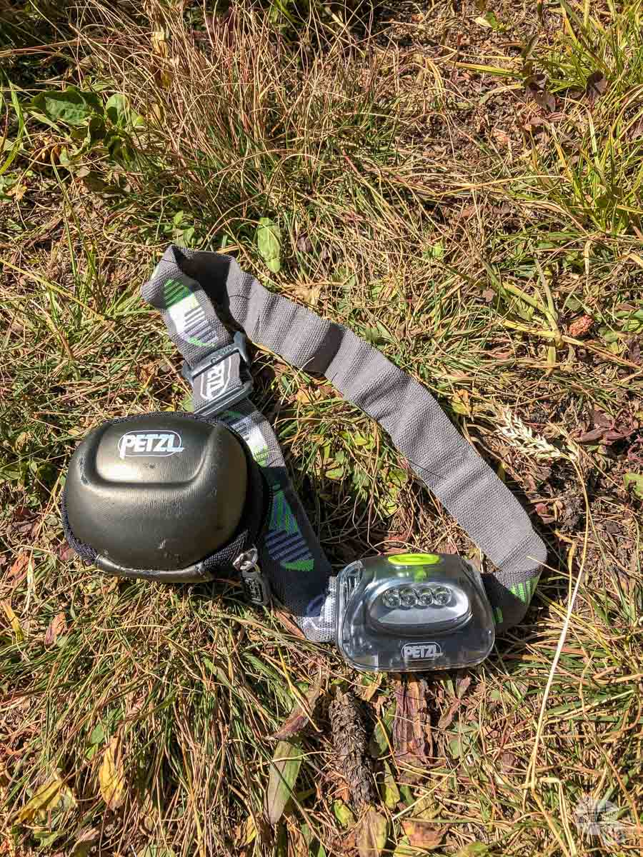We always keep a Petzl Tikka headlamp in our packs.