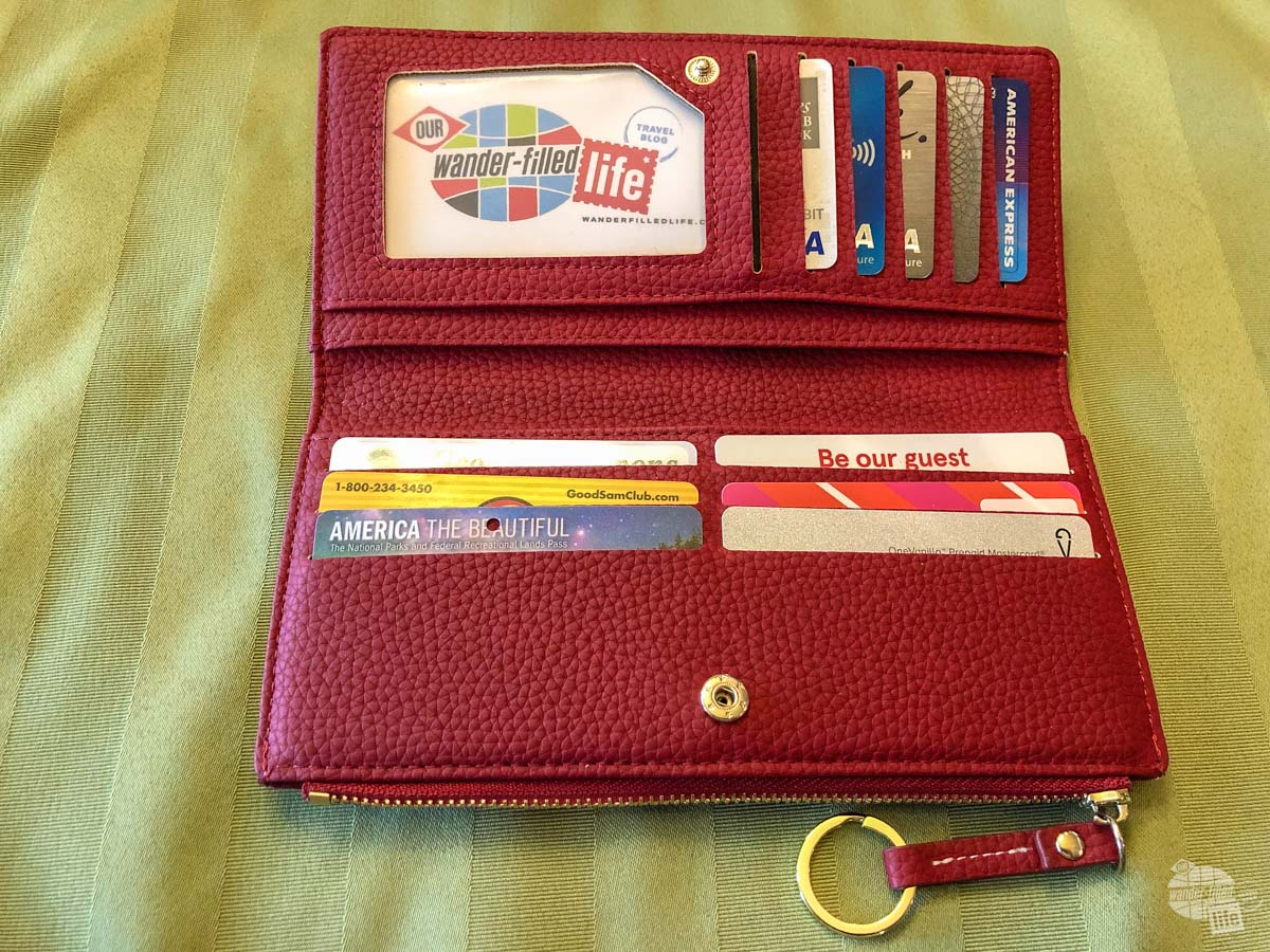 A red wallet with plenty of storage for credit cards and cash.