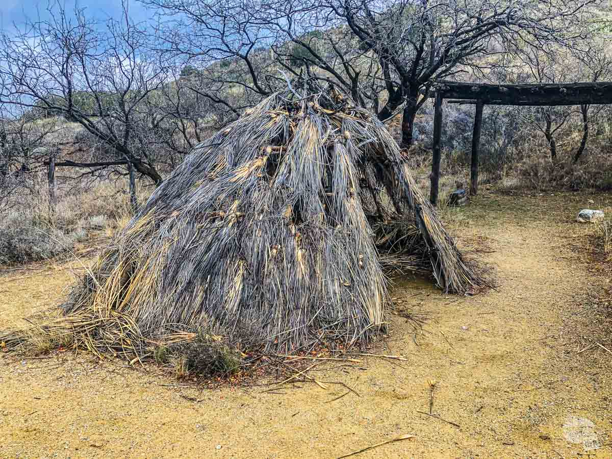An Apache shelter, which is designed to conceal the family in the brush and shelter them from the elements. It's also designed to be easy to move.