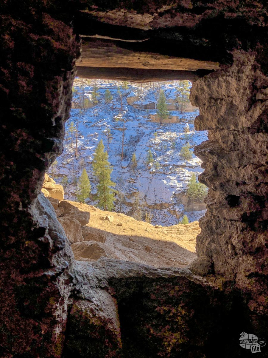 Looking out a window at Gila Cliff Dwellings.