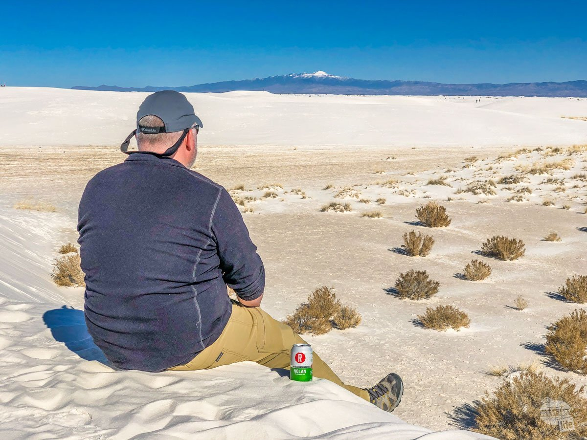 Grant enjoying a beer relaxing on the dunes in White Sands National Park
