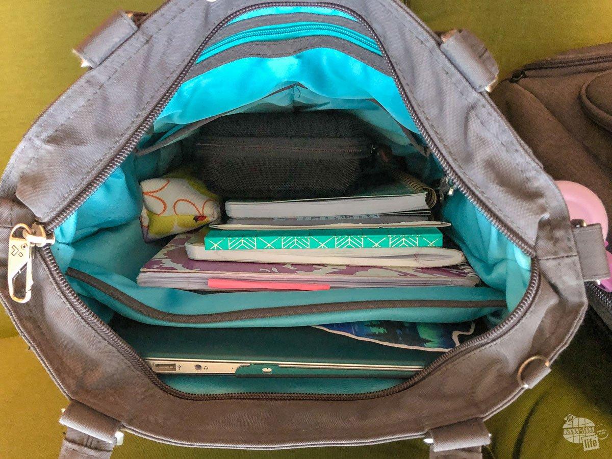 Looking inside Bonnie's laptop bag.