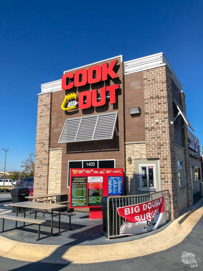 The front of a Cook Out restaurant.